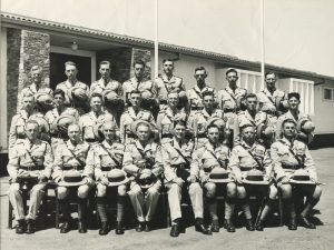 The first course at the Police Training School, Lilayi, 1955 back row, lto r: V.Carey, C Fletcher, M Beavis,-,-,-,- Middle row: -,-,K.Roberts,-,-,-,-, J.McFarlane Front row: R.Heckford, E.Jones, W.Hine, F.Roberts, JPI FForde, R.Taylor, D.Oliver, F.Berryman.