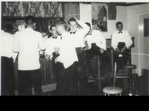 Bar on a dining –in night – Northern Rhodesia Police Mess – Livingstone – 1963 (?)(L-R): ? ; Dave Deptford (Mobile Unit); Dick Bellamy (PMC); Jock Boyd (M U); Bill Davidson; Brian Soulsby?; Peter Thornycroft.