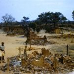 Patrick Kasonde in village destroyed by locals– Chief Chikwa area - Lumpa Campaign - 1964
